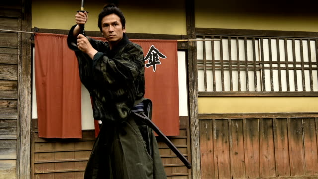 japanese ronin warrior draws his blade - sword stock videos & royalty-free footage