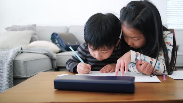 japanese schoolchildren doing homework in living room - randoseru stock videos & royalty-free footage