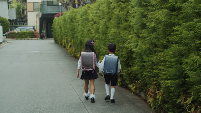Japanese Schoolchildren Walking Home