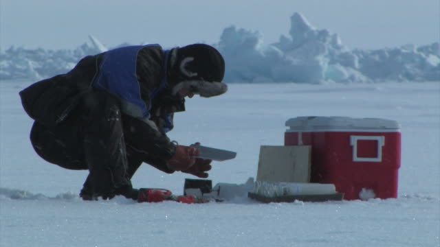 japanese scientist trims sample amidst light snow, the arctic, september 23, 2008 – from the historic 17-month expedition involving 250 scientists... - climate stock videos & royalty-free footage