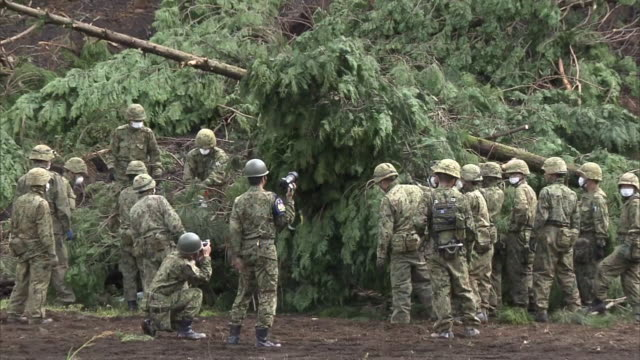 japanese self defence force and crane cars working in the landslide affected area in minami aso kumamoto after consecutive earthquake attacks in... - japan self defense forces stock videos and b-roll footage