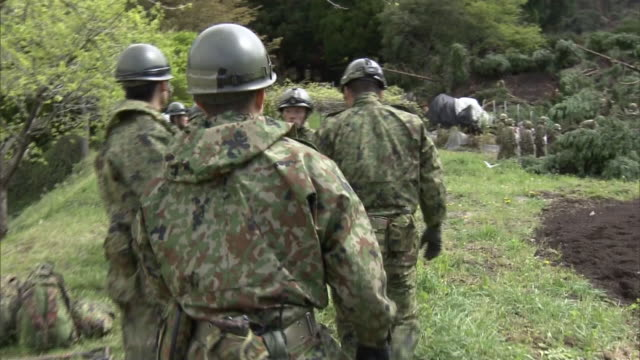 japanese self defence force crew investigating the landslide affected area after consecutive earthquake attacks in kumamoto 17th april around 9am - japan self defense forces stock videos and b-roll footage
