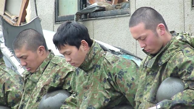 japanese selfdefence forces prepare for and mark one minute of silence to honour victims of the march 11 earthquake and tsunami before they continue... - japan self defense forces stock videos and b-roll footage