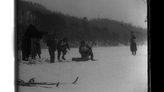 Japanese servicemen compete in the winter sports of the National Athletic Meet in Nikko Japan Prince Yasuhiko Asaka watches the ski jump competition