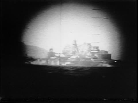 japanese ship burning at sea / crew of the uss tirante in the control room / crew member looking through periscope / view of a japanese colliery ship... - torpedo stock videos & royalty-free footage