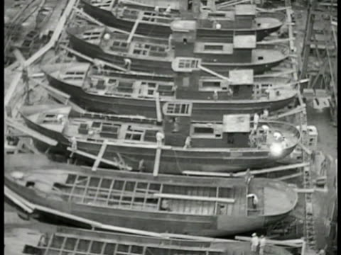 japanese ship yard hills bg xha ws rows of incomplete ships being constructed ms japanese workers riveting on top of ship ws completed boat launching... - skeppsbyggare bildbanksvideor och videomaterial från bakom kulisserna