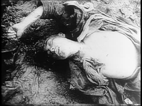 japanese soldier killed in the marianas lies on ground / japanese flag waves / young japanese boys march and practice military roles / youth in... - torture stock videos & royalty-free footage