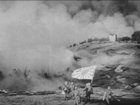 japanese soldiers banzai saluting/ japanese soldiers' corpses/ japanese army in action - 日本の軍事力点の映像素材/bロール