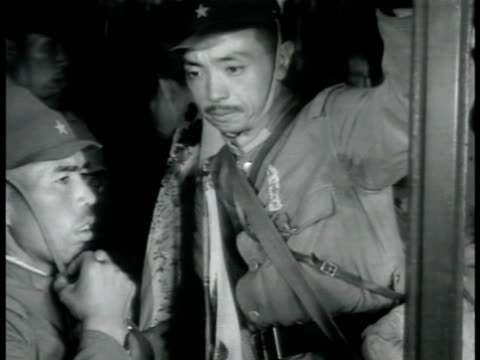 japanese soldiers boarding train w/ gear. japanese warship in harbor. vs naval officers on deck talking. soldier standing w/ bayonet. soldiers on... - bayonet stock videos & royalty-free footage