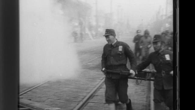 Japanese soldiers conduct an airraid drill during World War II putting out fires a neighborhood group rushes to save rice from a supply station...