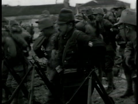 stockvideo's en b-roll-footage met japanese soldiers getting ready falling into line ms soldiers strapping on gear ws soldiers walking w/ flag ha ws soldiers in trucks turning from... - 1942