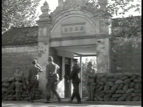 japanese soldiers guarding gate flag. entrance to japan army headquarters. japanese general. bomber airplane flying over pagoda. world war ii - japan flag stock videos & royalty-free footage
