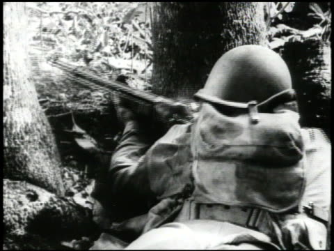 japanese soldiers in camouflage garments running from behind oak trees, behind us soldier firing browning automatic rifle between oak trees, behind... - camouflage stock videos & royalty-free footage