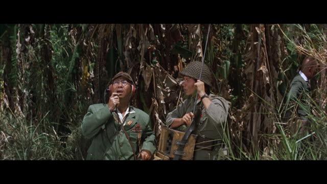 vídeos y material grabado en eventos de stock de ms td pan japanese soldiers in jungle one with telephone equipment outfi.  - walkie talkie