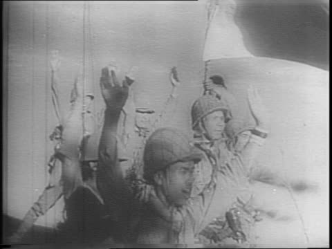 japanese soldiers make banzai sign at corregidor / celebrate under japanese flag after removing american flag / us fleet destroyers in water /... - surrendering stock videos & royalty-free footage