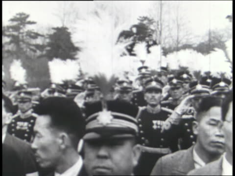 japanese soldiers march with rifles on their shoulders in a military review before their officers and emperor hirohito; photographs of hitler, mussolini and hirohito portray the three axis leaders. - achsenmächte stock-videos und b-roll-filmmaterial