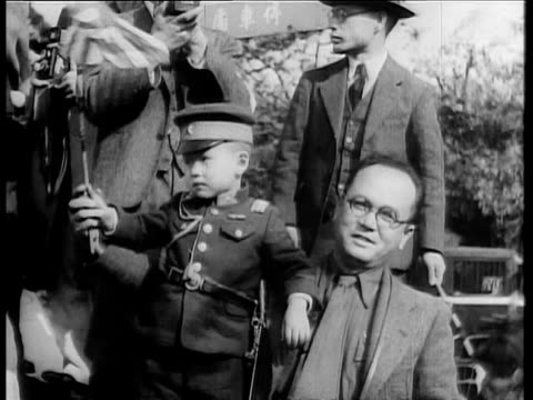 japanese soldiers marching on shanghai street / crowd waving japanese flags / asian man sitting with small boy in uniform waving japanese flag / rows... - 1932 stock videos & royalty-free footage
