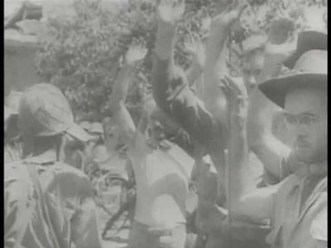japanese soldiers w/ captured allied soldiers. unidentified soldier standing w/ us commander jonathan wainwright iv. japanese commander lt. general... - pacific war video stock e b–roll