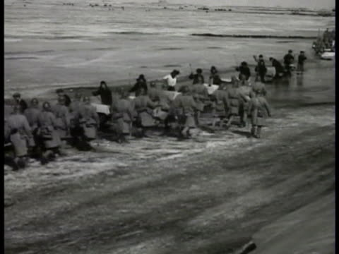 japanese soldiers walking japanese soldiers riding in open cars in motorized sleds climbing out of trucks japanese soldiers firing wheeled artillery - 1932 stock videos and b-roll footage