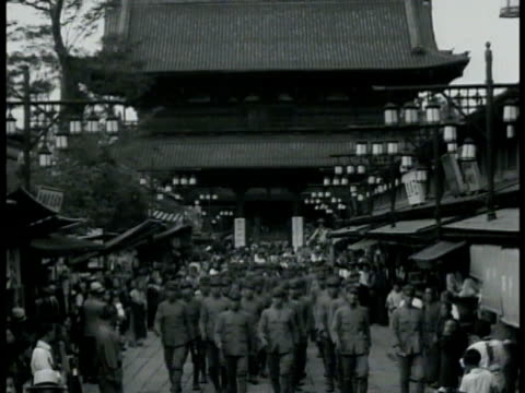 japanese soldiers walking through market temple building bg ws women in kimonos in marketplace ha ls women marching w/ japan flags crowded market... - temple street market stock videos and b-roll footage