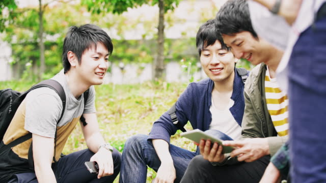ws japanese students relaxing in the park - japanese culture stock videos & royalty-free footage
