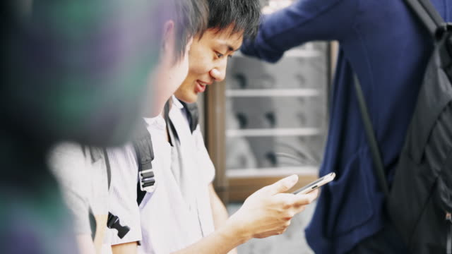 R/F MS Japanese students using smartphone while waiting on bus