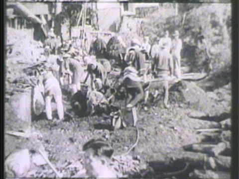 japanese survivors digging through debris two males carrying stretcher ha ms survivors on line for food ws pan people standing in debris rubble... - 1923 stock videos & royalty-free footage