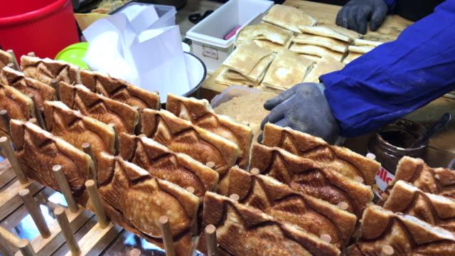 japanese taiyaki bread , myeongdong street food , seoul , south korea. - korean culture stock videos & royalty-free footage