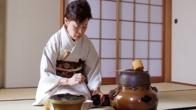 japanese tea master preparing to make a cup of traditional matcha tea - kimono stock videos & royalty-free footage
