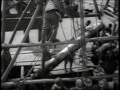 japanese troops building a bridge including driving piling with pulleys ropes and boats / china - bridge built structure stock videos and b-roll footage