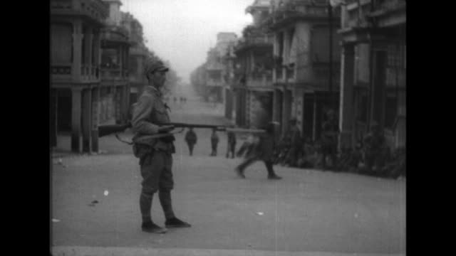 japanese troops capture hong kong and march british prisoners of war through the streets - battleship stock videos & royalty-free footage