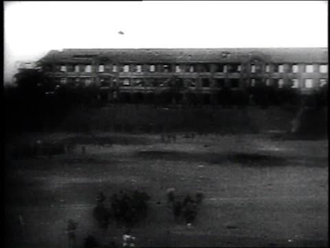 vídeos de stock e filmes b-roll de japanese troops take down american flag and raise there own / corregidor, philippines - baixar