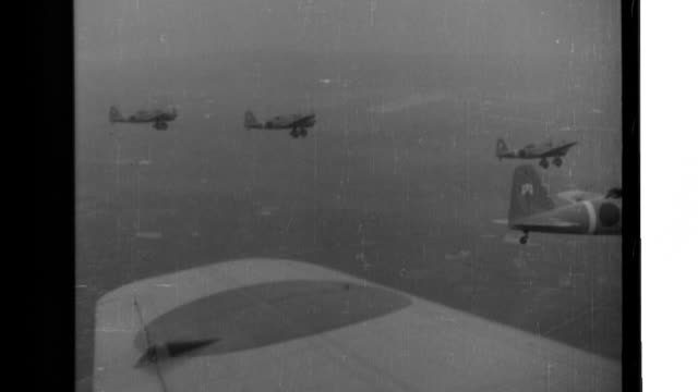 Japanese Type 97 Light Bombers attack China from the air ground soldiers shoot machine guns infantry units shoot machine guns and rifles as they...