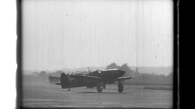 Japanese TypeThree fighters takeoff to intercept American bombers and have success as smoke rises from a downed B29