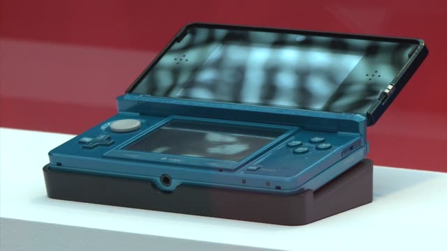 japanese videogame titan nintendo announced that the hotly anticipated glasses-free 3-d version of its handheld gaming gadget will hit europe and the... - titan moon stock videos & royalty-free footage