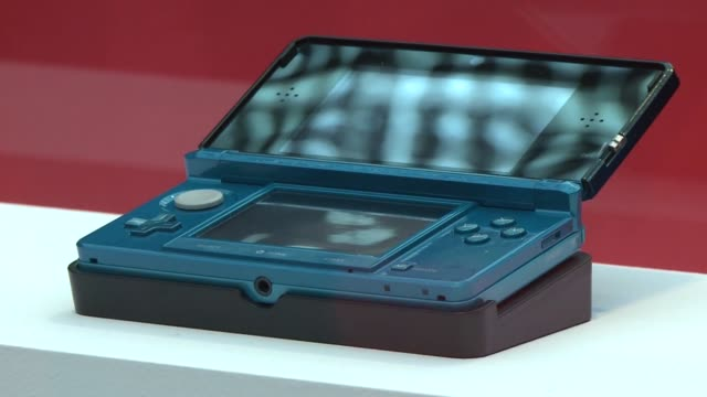 japanese videogame titan nintendo on wednesday announced that the hotly anticipated glassesfree 3-d version of its handheld gaming gadget will hit... - titan moon stock videos & royalty-free footage