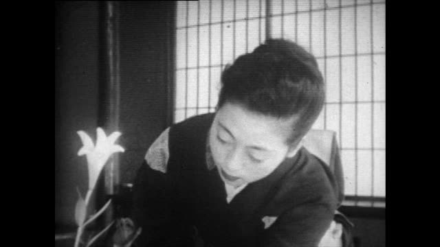 japanese woman arranges flowers in home; 1958 - femininity stock videos & royalty-free footage