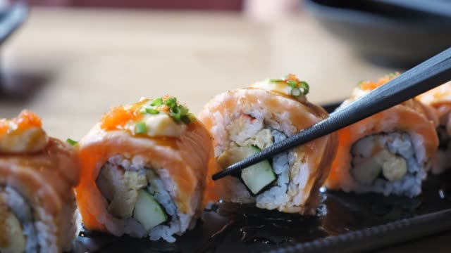 japanese woman eating sushi in restaurant - wasabi sauce stock videos and b-roll footage