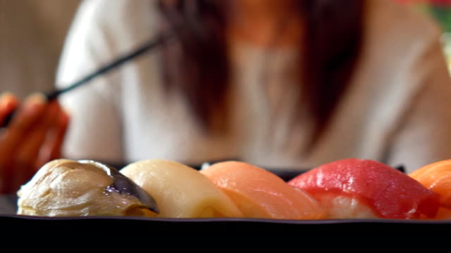 japanese woman eating sushi - seafood stock videos & royalty-free footage
