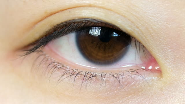 japanese woman eyeball macro - eyelid stock videos and b-roll footage