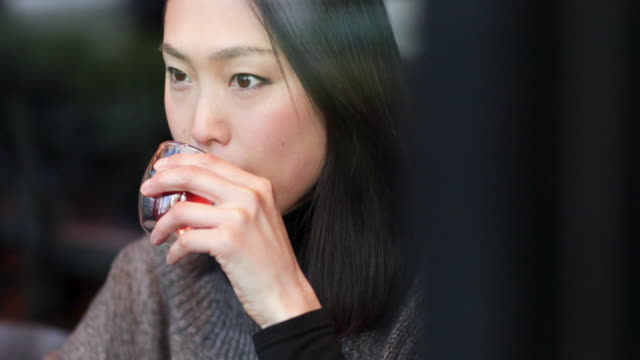 japanese woman in drinking green tea and using smart phone. tokyo, japan - tè raccolto video stock e b–roll