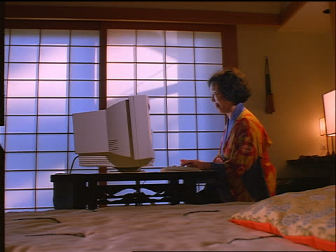 profile japanese woman in kimono typing on computer in front of shoji screen - kimono stock videos and b-roll footage