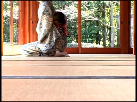 Japanese Woman In Yukata Sitting Japanese Style Rising,Fukuoka, JapanJapanese woman in kimono