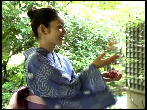 Japanese Woman In Yukata Tossing,Fukuoka, JapanJapanese woman in kimono