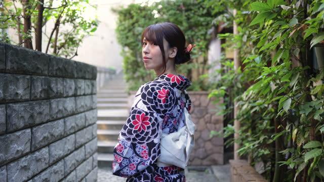 japanese woman in yukata walking in narrow footpath - narrow stock videos & royalty-free footage