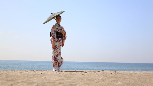japanese woman on the beach - only japanese stock videos & royalty-free footage