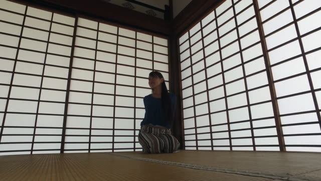 japanese woman peacefully meditating at home - tatami mat stock videos and b-roll footage