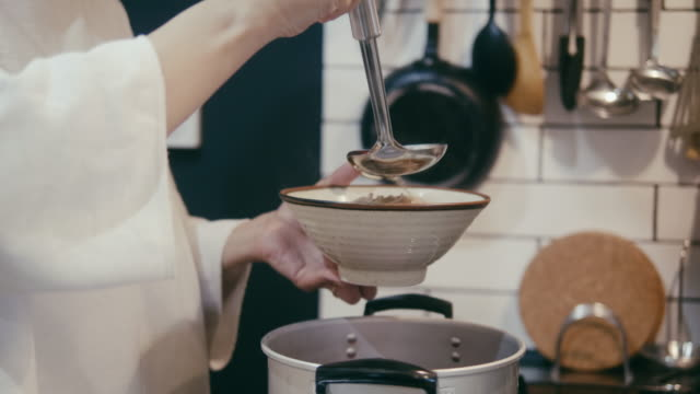 japanese woman pouring broth on buckwheat soba noodles - domestic kitchen stock videos & royalty-free footage
