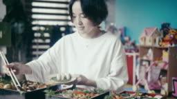 Japanese woman preparing Osechi Ryori on New Year's Eve