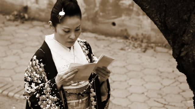 Japanese woman reading old letter